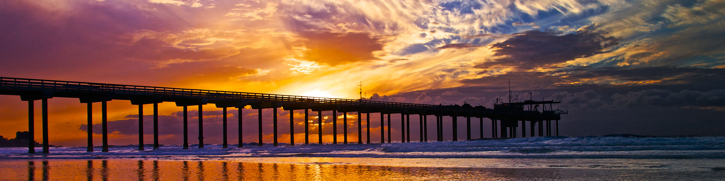 Scripps Pier silhouetted against orange sunset